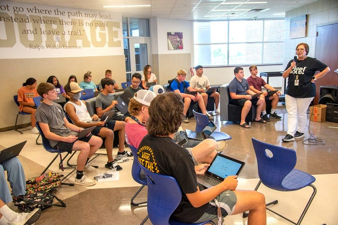 Midlothian High School students pick up their schedules on Aug. 4 in preparation for the start of the 2021-2022 school year, which began last Monday, Aug. 16.