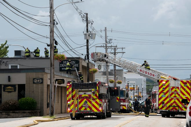 Main Street was clogged with fire apparatus while Hudson firefighters extinguished a fire at Hudson Dental Care at 241 Main St. in Hudson under control, Aug. 23, 2021.