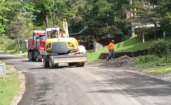 Town of Eaton Highway Department workers clear debris along Westcott Road Aug. 23 in Eaton.