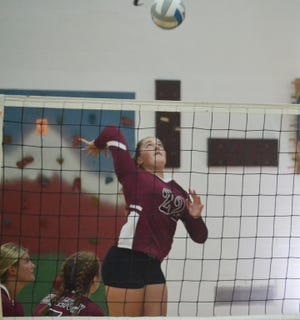 Charlevoix's Grace Lentz winds up for a shot during the Pellston Invite Saturday.