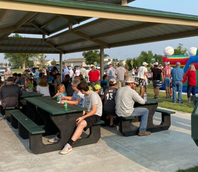 """Community members gathered at the swimming pool park in Greensburg on Aug. 3 to attend the inaugural event for """"National Night Out."""" The event, put on by the Greensburg Police Department and the Youth Explorer Program, included live music from the Cynthia Rausch Band, activities, and free hamburgers and hot dogs."""