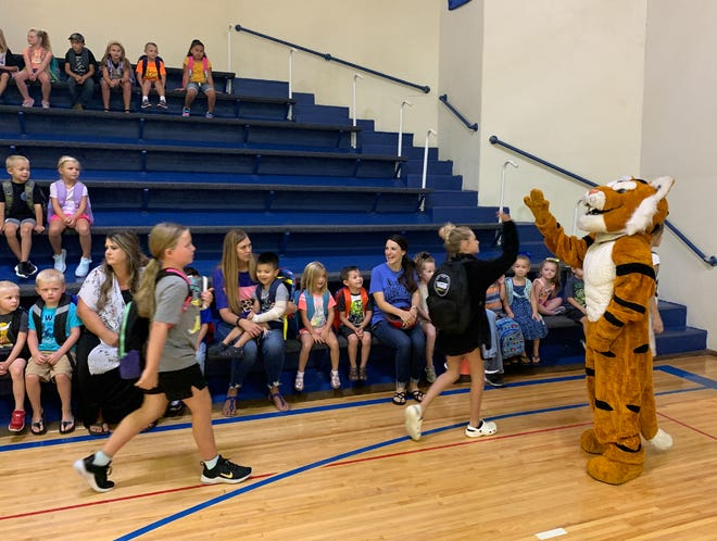 Tyrone the Tiger greeted students on the second day of school this year. The first day of classes was held Aug. 19.