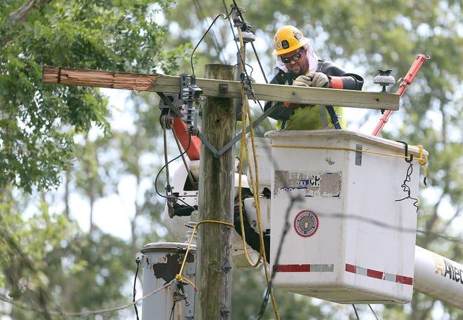 A National Grid lineman works on repairing a broken pole  in Wakefield.