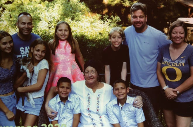 Gretchen Hult Pierce, center bottom row, poses with her six grandchildren and two kids.