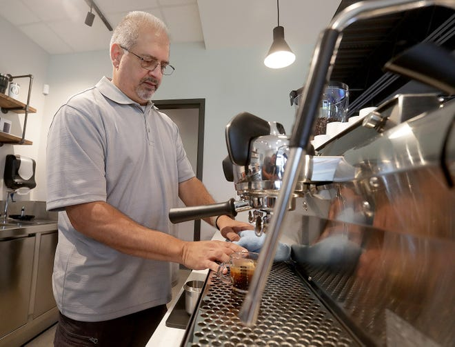 Frank Genovese, owner of Ohio Roasting Co. in Jackson Township, makes an espresso while testing out his coffee blends for the shop's opening in the near future. Coffee-makers have seen bean prices climb in the past year.