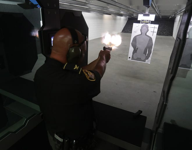 Stark County Chief Deputy John Oliver, who serves as a firearms instructor, practices during an exercise Monday at the new Sheriff's Office Law Enforcement Training Center in Massillon.