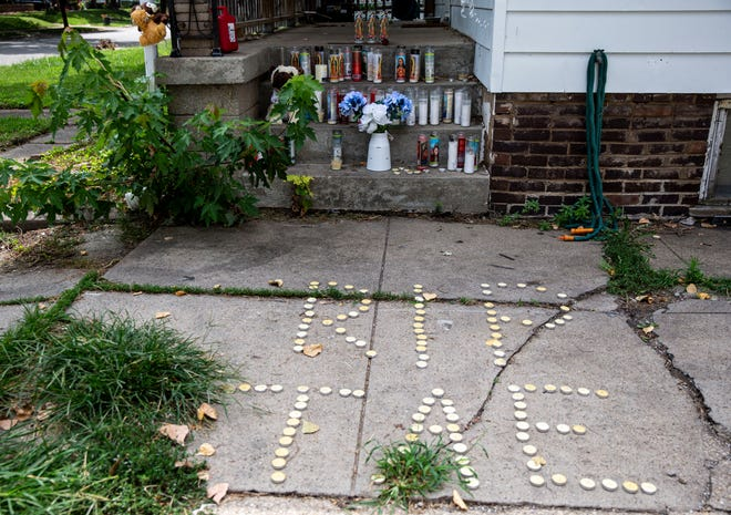 A memorial of candles and stuffed animals has been set up on the steps of the home where Savante English, Keyera Gant and Bryant K. Williams were killed in the 2500 block of South 10th Street. [Justin L. Fowler/The State Journal-Register]