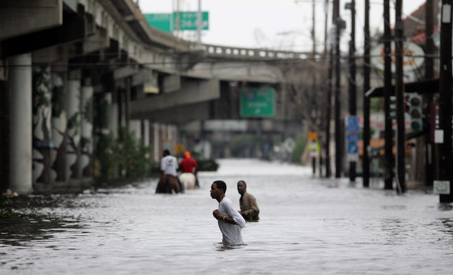 New Orleans residents walk through chest floodwater after Hurricane Katrina made landfall on the Louisiana coast on Aug. 29, 2005.