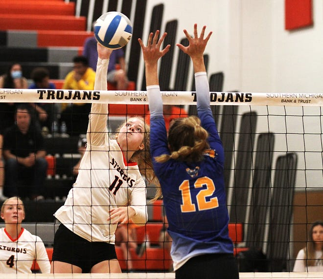 Juliette Schroeder of Sturgis smashes home a kill against Centreville during play on Friday evening.