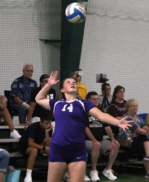 Brealyn Lasky serves up a ball for Bronson at Battle Creek on Saturday.