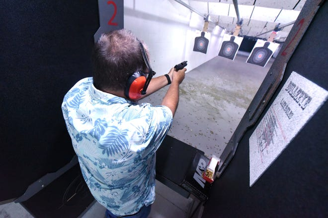 In this September 2020 photo, Bizz Baker shoots on the firing range while taking a concealed carry class from firearms instructor Tony Wisyanski.