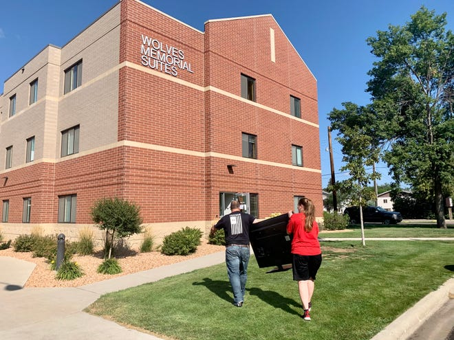 Undergraduate student Mya Hagenson's family helps her move into a residence hall at Northern State University Saturday.