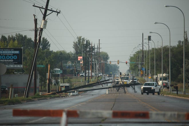 Heavy winds that were part of a Sunday night thunderstorm knocked on power lines on North Roosevelt Street. They had been repaired by Monday morning.