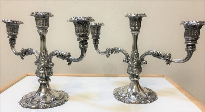 These candelabra were manufactured in the early 20th century, and are made of electroplated silver on lead. [Submitted photo]