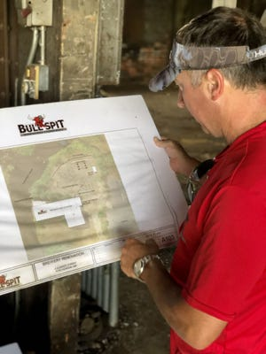 Bull Spit Brewing Co. CEO Keith Kopley reviews plans for his new brewery at 4 Summer Drive in Winchendon. The brewery will open sometime next summer.