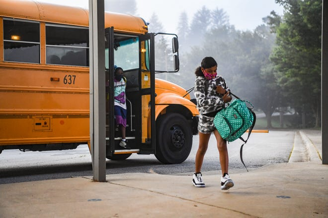 Buncombe County Schools and Asheville City Schools resumed today, August 23, 2021. Parents, families, guardians, and even some pets came through the drop-off area at Ira B. Jones Elementary School in Asheville.