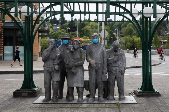 Statues covered with face masks in Seattle's Fremont neighborhood, April 26, 2020.