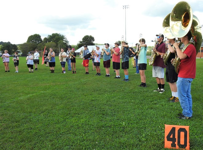 The River View High School Marching Black Bears practice recently outside and without masks. Pandemic restrictions have been loosened and the band will be able to play for all football games and band contests this school year.