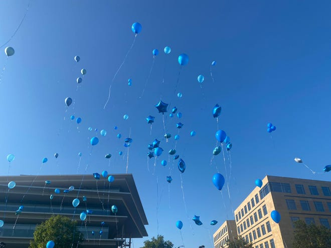 Hundreds attended a vigil and released balloons for beloved Des Moines Public Schools teacher and mentor, Kristopher Rollins, on August 22, 2021 in downtown Des Moines.