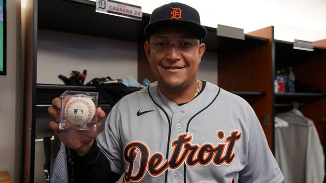 Miguel Cabrera of Detroit Tigers holds the ball he hit for his 500th home run at the Rogers Center in Toronto, August 22, 2021.