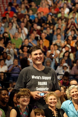 In this Sept. 12, 2009 file photo, Igor Vovkovinskiy, 27, of Rochester, Minn, standing 7-feet and 8-inches tall, listens to President Barack Obama, not pictured, during a health insurance reform rally in Minneapolis.