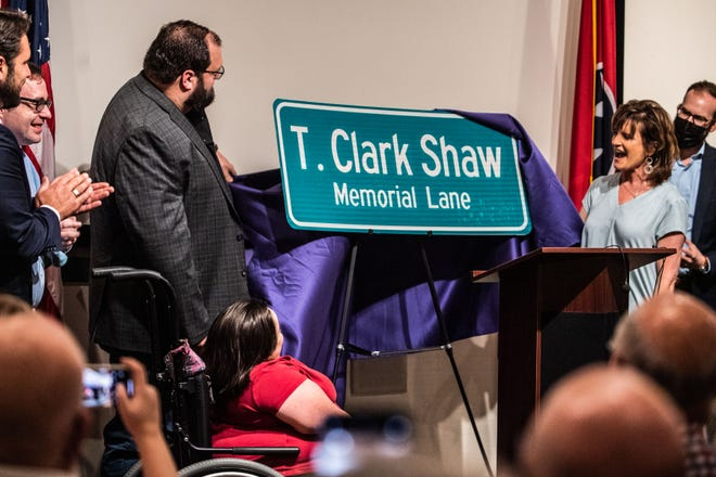 Juanita, right, and Brooks Shaw unveil the T. Clark Shaw Memorial lane during the Service of Dedication on Friday, August 20, 2021, in Jackson, Tenn.