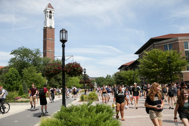 Students walk across Purdue University's campus, Monday, Aug. 23, 2021 in West Lafayette.