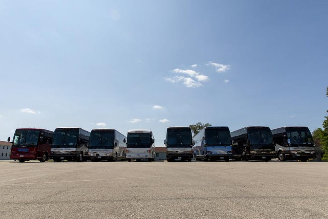 A fleet of buses is staged for the arrival of Afghan evacuees at Fort McCoy, Wisconsin, Aug. 17, 2021. The Department of Defense, in support of the Department of State, is providing transportation and temporary housing in support of Operation Allies Refuge.