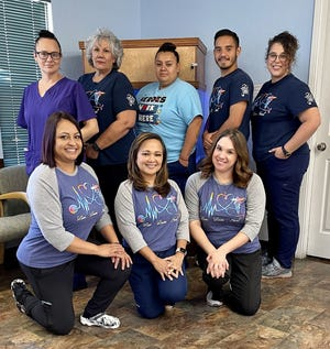 Southwest Pediatrics and Family Care staff includes, standing from left, Lisa Reyes, Gloria Marquez, Myra Torres, David Villagrana and Carmen Seltazer. Kneeling from left are Venus Robles, FNP-C; Florence Roque,, DNP, CPNP; and Melissa Watson, FNP-C. Not pictured are Biviana Ramirez and Jacklyn Sanchez.