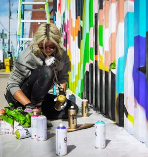 Milwaukee mural artist Emma Daisy is bringing her vibrant, joyful artistic side to Oshkosh. She'll be painting the city's second mural, at 440 N. Main St., on the wall in the courtyard next to Gardina's Kitchen and Bar.