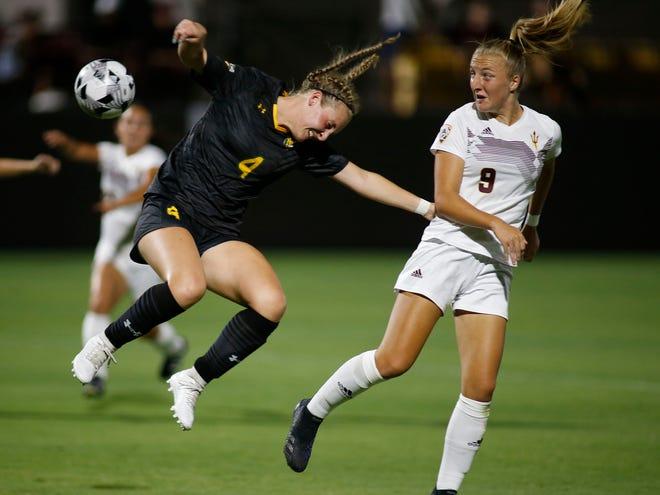 ASU's Nicole Douglas 9, heads the ball past SLU's Tilly Deacon 4, during their game Aug, 22, 2021 in Tempe.