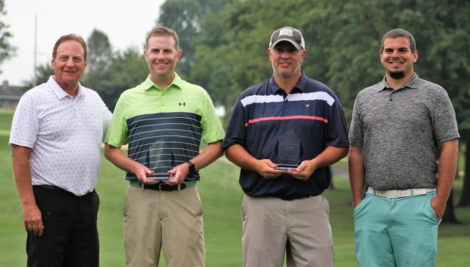Chris Gebhard, second from left, and Jim Gardner, second from right, receive their Lebanon County Better Ball championship trophies from  Tony Deraco, left, and Jon Day, far right.