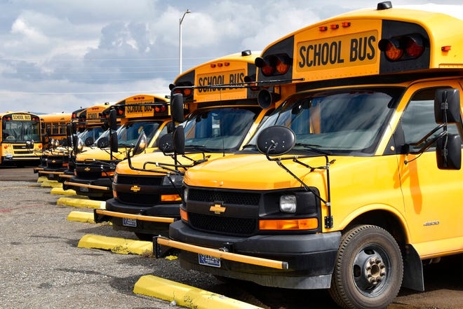 School buses parked in Helena, Mont., ahead of the beginning of the school year, Friday, Aug. 20, 2021.