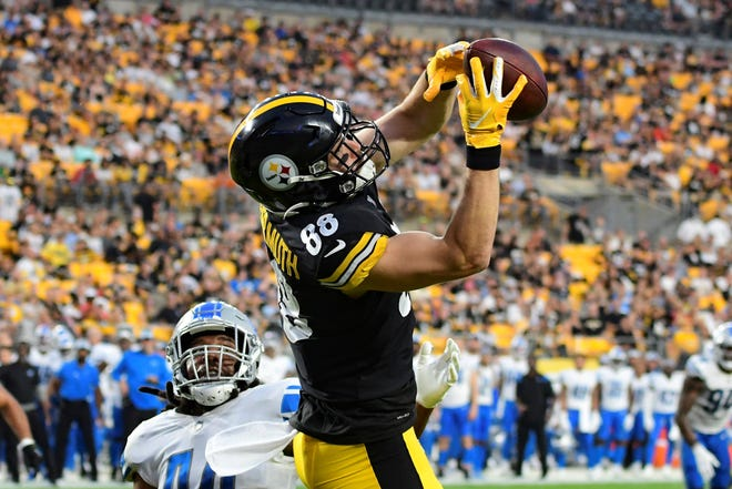 Pittsburgh Steelers tight end Pat Freiermuth (88) makes a touchdown catch in front of Detroit Lions linebacker Jalen Reeves-Maybin (44) during the first half of an NFL preseason football game Saturday, Aug. 21, 2021, in Pittsburgh. (AP Photo/Fred Vuich)