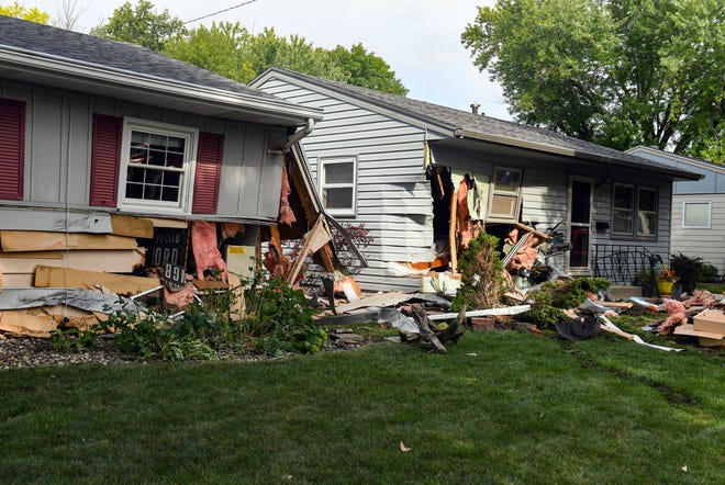 The aftermath of a truck slamming into the sides of two houses remains on Monday, August 23, 2021 on S Jessica Avenue in Sioux Falls.