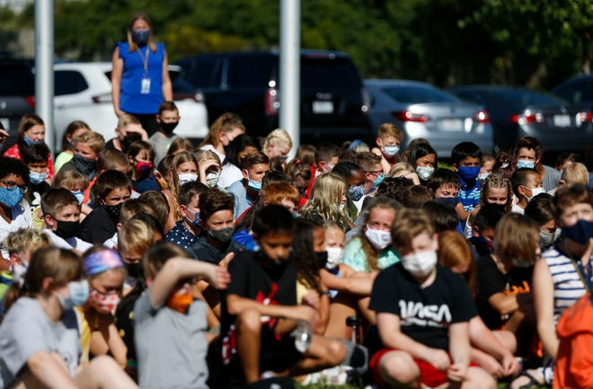 Students at Wilson's Creek Intermediate School listen to speakers during an outdoor assembly on the first day of classes on Monday, Aug. 23, 2021.