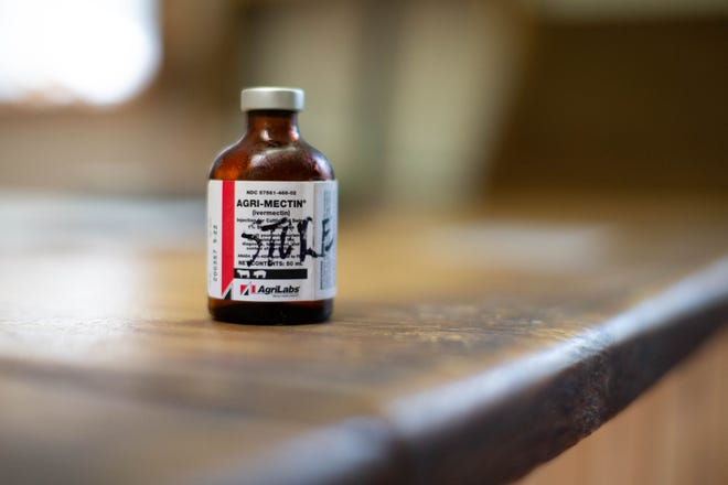 A bottle of ivermectin sits on a counter.