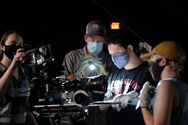 BFA Production Students at FSU Film School pause for a photo on set.