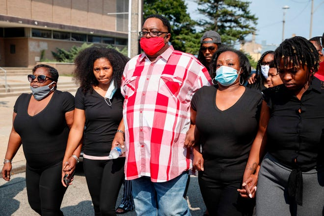 Jacob Blake Sr. and Julia Jackson walk with family members outside of the county courthouse in Kenosha, Wis., for a news conference in 2020 about the police shooting of their son.