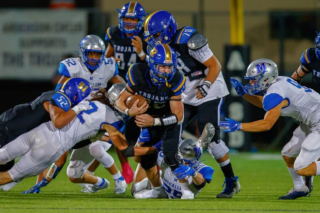 Anderson running back Colin Page, swarmed by the McCallum defense in the annual Taco Shack Bowl in 2020, figures to be the leader of the Trojans offense. McCallum hopes to bounce back with QB Jaxon Rosales.