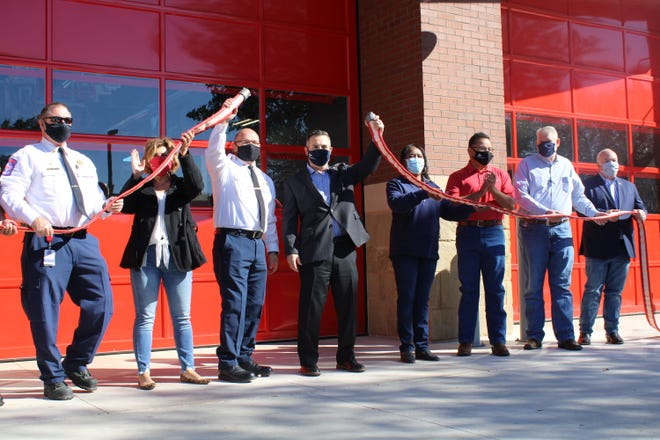 Round Rock officials, including Mayor Craig Morgan at center, celebrate the grand opening of Fire Station 3 in December.  This year's city budget proposes anew, 14-memberteam of mental health first responders.