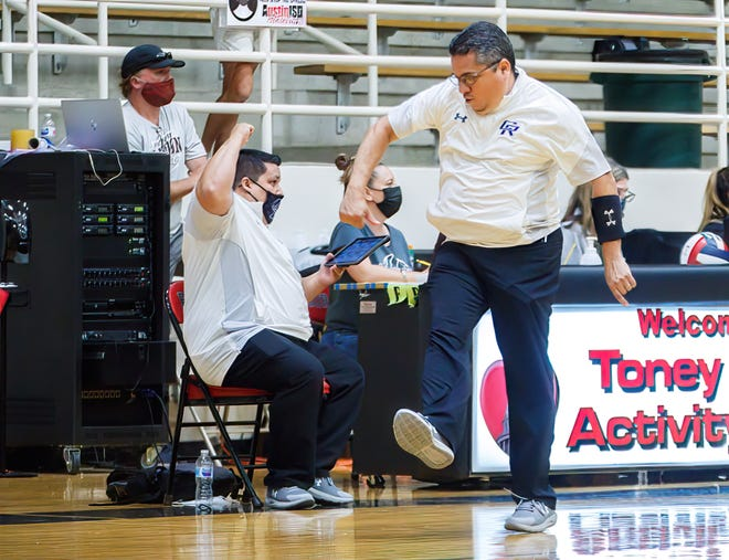 Second-year Cedar Ridge coach Eric Soto dances in celebration after a Raiders point against Austin High at the nondistrict volleyball game on Aug. 16 at Toney Burger Activity Center. Cedar Ridge and the four other Round Rock teams all entered this week with a winning record.