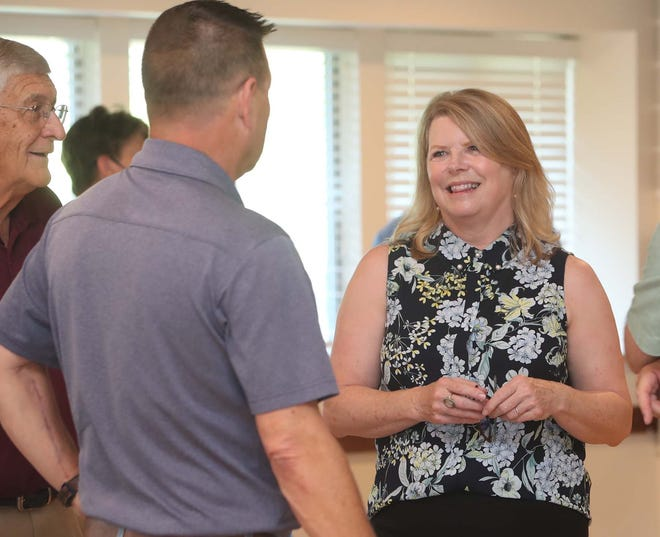 Julie McClain, the new executive director of the Stow-Munroe Falls Chamber of Commerce, talks with members at a meet and greet at the Leona Farris Lodge in Silver Springs Park on Aug. 24. One of McClain's goals is to reconnect with the existing membership and reach out to younger business owners in the community.