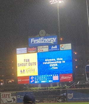 """In this image from Abbey Marshall, """"Tim"""" breaks up with """"Alyssa"""" on the Canal Park scoreboard."""
