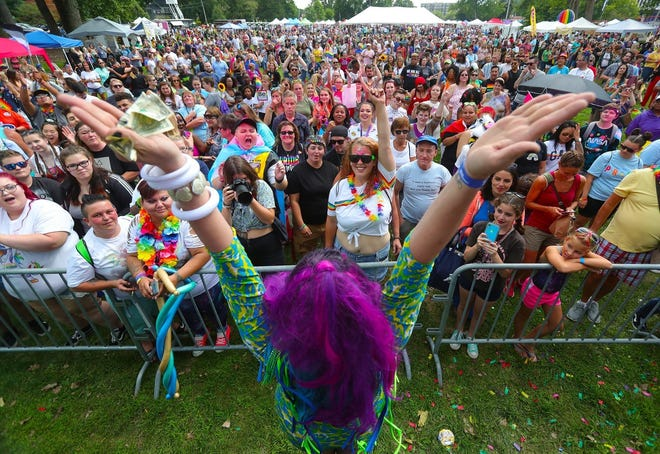 Fans cheer and dance with a drag queen during the 2019 Akron Pride Festival at Hardesty Park. The Pride Festival returns to Akron this Saturday after a year off because of the COVID-19 pandemic.