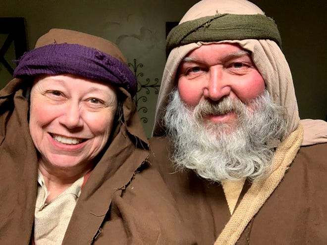 """Debra and Derrol Wells try out their first-century costumes before traveling to Midlothian to be extras in the Feb. 10 Sermon on the Mount sequence of """"The Chosen."""""""