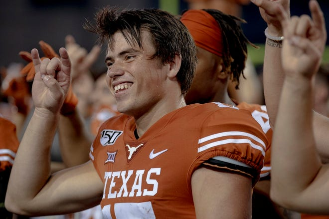 Texas kicker Cameron Dicker celebrates after kicking the game-winning field goal to beat Kansas State 27-24 in 2019. Dicker may pull triple duty this fall if he also has to assume punting duties.