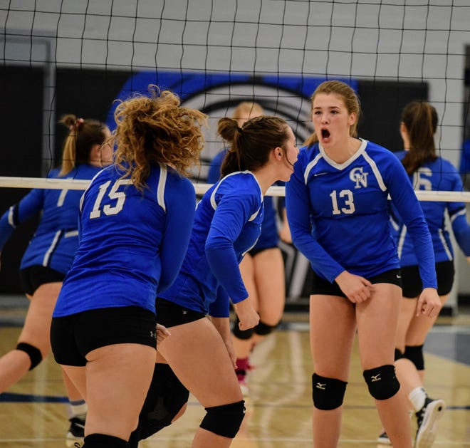 Jenna Hill (13) and the rest of the Colo-NESCO volleyball team hope to do more celebrating in 2021 under the leadership of new coach Karissa Rempe
