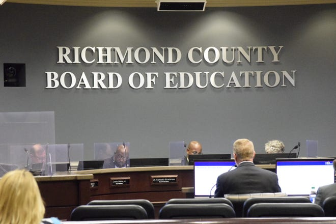 Richmond County Chief Finance Officer Bobby Smith, back turned to camera, recommends raising the millage to 19.312 mills during a special called board of education meeting on Tuesday, Aug. 24, 2021.