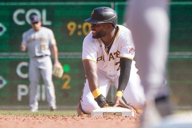 Pittsburgh Pirates' Gregory Polanco holds the bag after stealing against the Milwaukee Brewers in the first game of a split doubleheader baseball game, Saturday, Aug. 14, 2021, in Pittsburgh. The Pirates won 14-4. (AP Photo/Keith Srakocic)